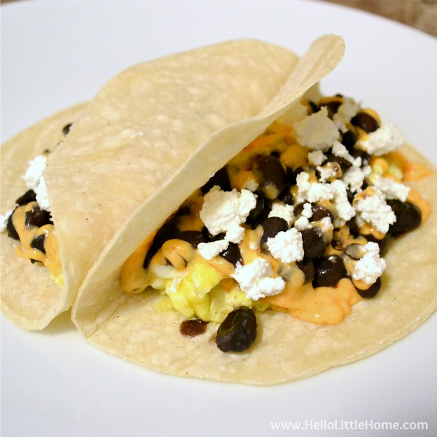 Egg and Black Bean Tacos with Spicy Sriracha Mayo ... one of 100 Vegetarian Game Day Recipes! Get ready for the big game with over 100 vegetarian and vegan appetizers, soups, chilis, main dishes, sandwiches, breakfast, desserts, and more that will make your next football watching party unforgettable! | Hello Little Home