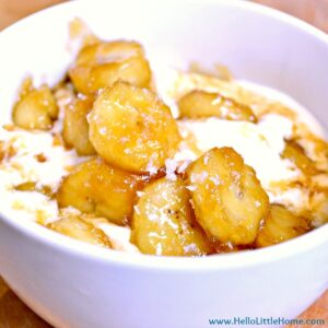 A bowl of ice cream topped with salted caramelized bananas.