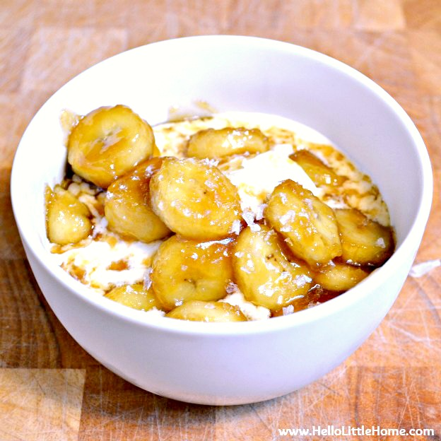 A bowl of ice cream topped with a caramel banana sauce.