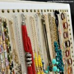 Getting my jewelry organized - hanging up my necklaces