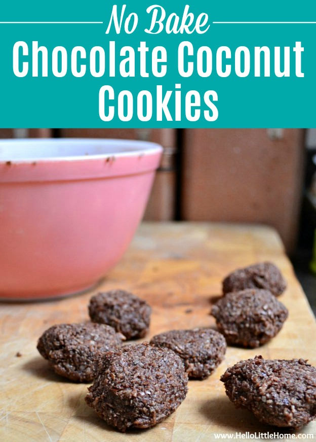 No Bake Chocolate Coconut Cookies on a wood cutting board with a pink mixing bowl in the background.