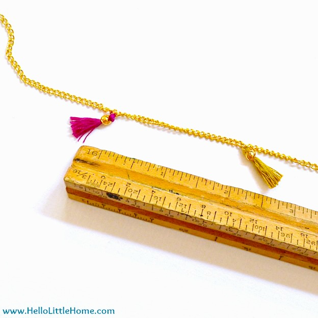 Measuring the space between tassels with a ruler.