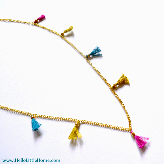 A DIY Tasseled Necklace on a white background.