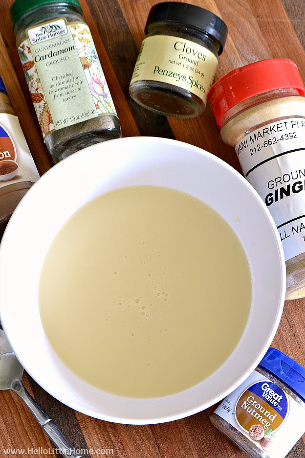 Sweetened condensed milk surrounded by spices for Easy Chai Tea Mix | Hello Little Home