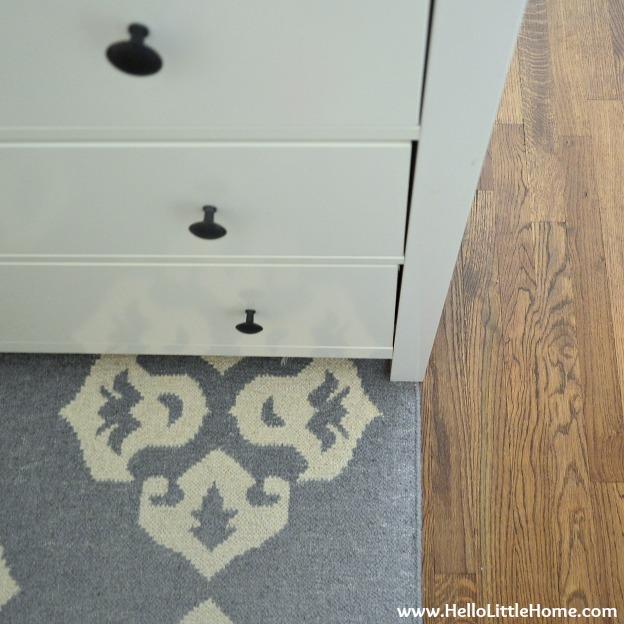 Hardwood floor and rug detail.
