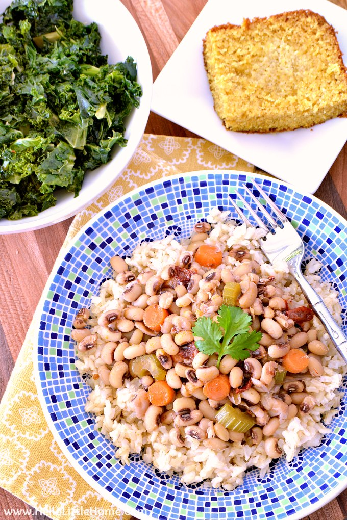Vegan Black Eyed Peas Recipe on a Wood Table with Greens and Cornbread.