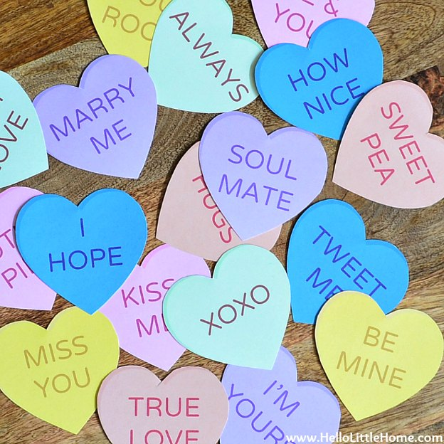 DIY Conversation Heart Banner with Free Printables ... cute, sweet, and so easy to make, this adorable Valentine's Day heart banner is the perfect way to decorate for V-day! Get the spanish version, too! | Hello LIttle Home