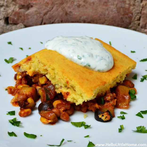 Tamale Pie with Cilantro-Lime Yogurt Sauce ... one of 100 Vegetarian Game Day Recipes! Get ready for the big game with over 100 vegetarian and vegan appetizers, soups, chilis, main dishes, sandwiches, breakfast, desserts, and more that will make your next football watching party unforgettable! | Hello Little Home