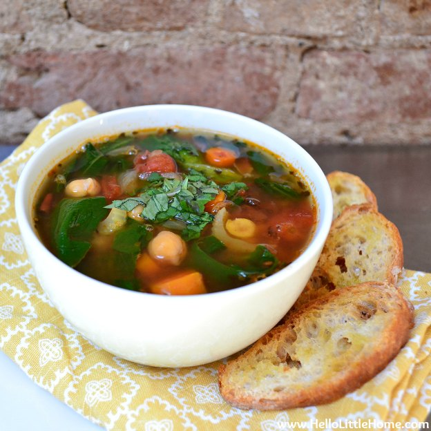 Vegetable Soup with Chickpeas and Kale & Crunchy Garlic Toasts ... one of 100 Vegetarian Game Day Recipes! Get ready for the big game with over 100 vegetarian and vegan appetizers, soups, chilis, main dishes, sandwiches, breakfast, desserts, and more that will make your next football watching party unforgettable! | Hello Little Home
