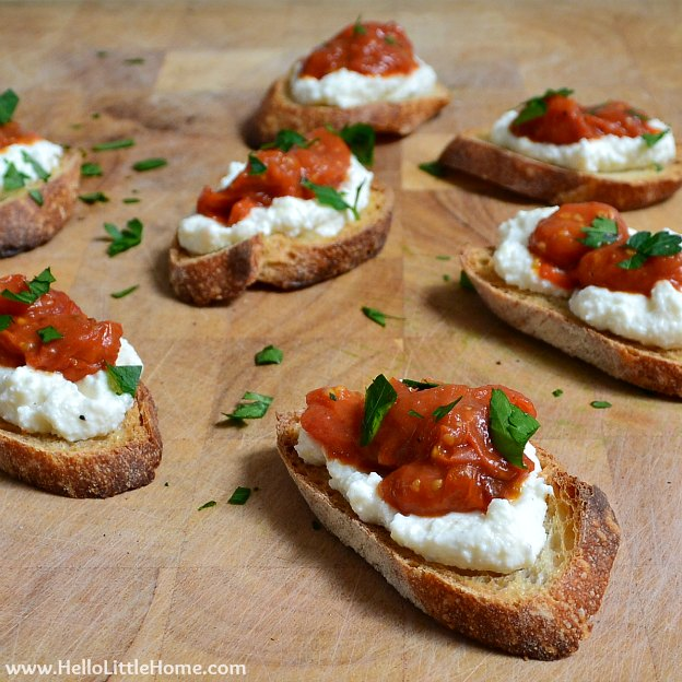 Bruschetta with Pan-Roasted Tomatoes & Ricotta ... Get this easy recipe + 100 other vegetarian winter recipes that are perfect for any occassion! | Hello Little Home