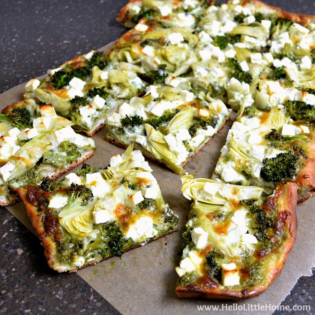 Green Pizza with Pesto, Feta, Artichoke, and Broccoli ... a delicious vegetarian pizza recipe! This easy veggie pizza recipe makes a great weeknight dinner idea! | Hello Little Home
