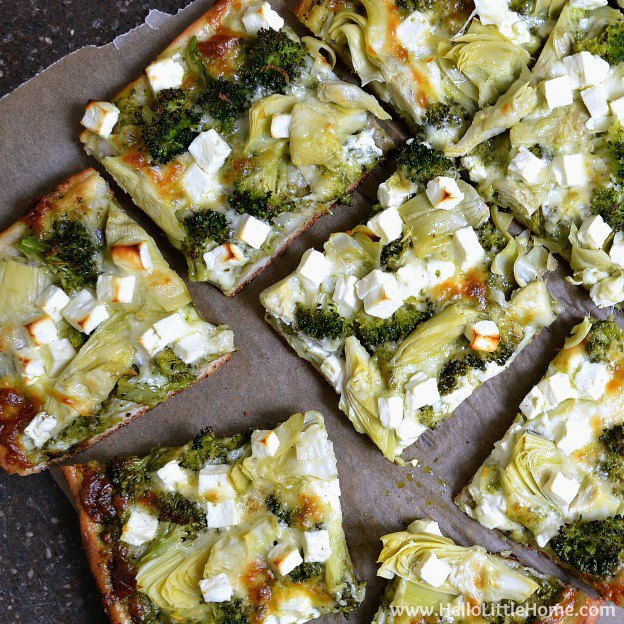 Green Pizza with Pesto, Feta, Artichokes & Broccoli ... a delicious vegetarian pizza recipe! This easy veggie pizza recipe makes a great weeknight dinner idea! | Hello Little Home