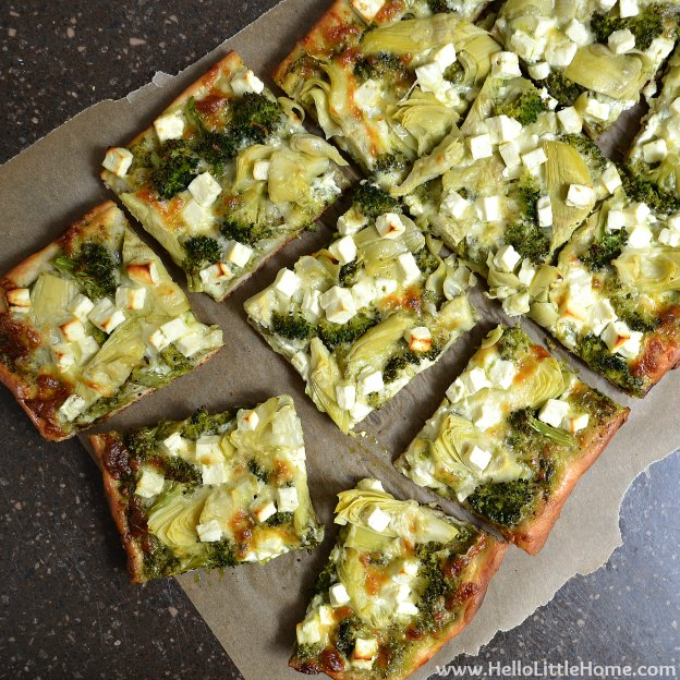 Green Pizza with Pesto, Feta, Artichokes & Broccoli ... Get this easy recipe + 100 other vegetarian winter recipes that are perfect for any occassion! | Hello Little Home