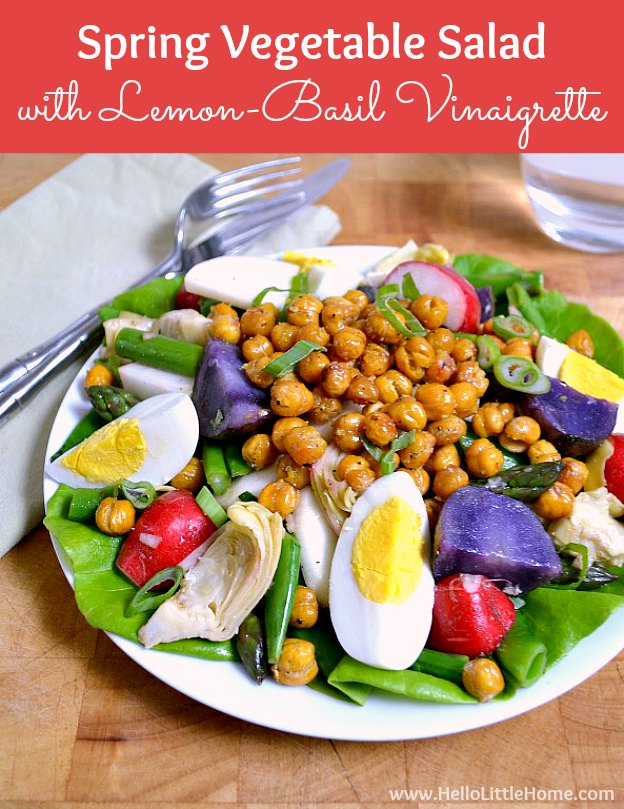 Spring Vegetable Salad with Lemon Basil Vinaigrette and Roasted Chickpeas ... a delicious seasonal recipe! Make this easy vegan salad anytime you're craving a light, healthy meal! It's packed full of veggies and makes a wonderful vegetarian lunch or dinner! | Hello Little Home