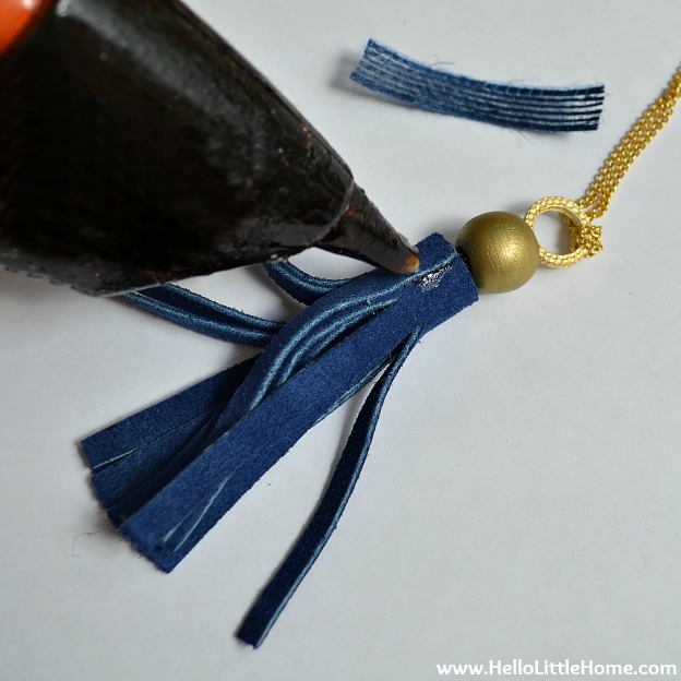 DIY Suede Tassels: Attaching the Ribbon | Hello Little Home