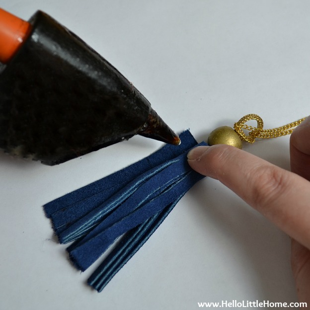 DIY Suede Tassels: Rolling up the Tassel | Hello Little Home