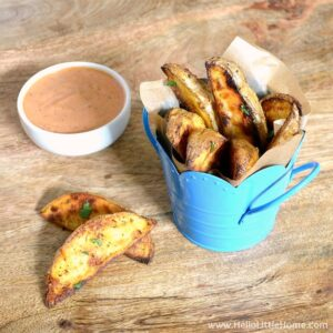 Old Bay Roasted Potato Wedges served with dipping sauce.