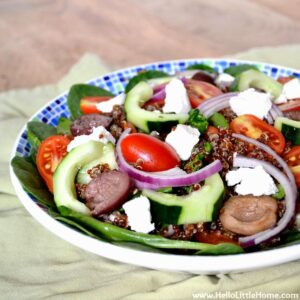 Healthy Greek Quinoa Salad with Veggies, Feta, and Greek Salad Dressing.