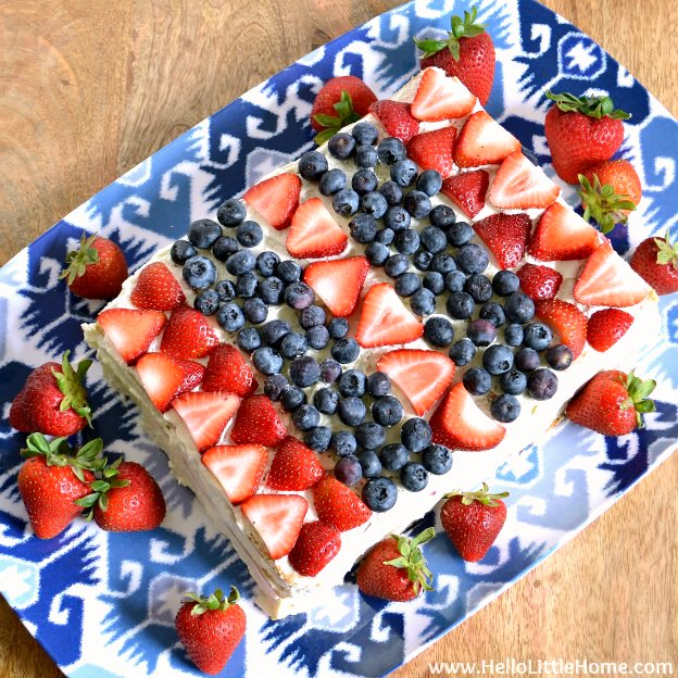 Red, White, and Blue Icebox Cake ... a delicious no bake dessert that's perfect for any patriotic get together, like the 4th of July! This easy, no bake icebox cake recipe is packed with fresh strawberries and blueberries, layered with a light lemon cheesecake and graham crackers. The perfect summer treat! | Hello Little Home