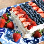 30 Amazing Red, White, and Blue Dessert Recipes, like this Red, White, and Blue Icebox Cake, perfect for Fourth of July, Memorial Day, Labor Day, or any summer party! With everything from fruit salads to cheesecakes, these delicious patriotic dessert ideas run the gamut from healthy to decadent! | Hello Little Home