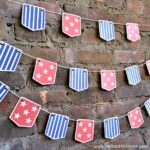 DIY Stars and Stripes Bunting ... a fun + easy way to add patriotic decor to your home, perfect for 4th of July, Memorial Day, or any festive occasion! Get the free printable for this American flag inspired banner, then assemble it in minutes. This DIY red, white, and blue patriotic bunting is the perfect way to add a dose of stars and stripes to your home! | Hello Little Home