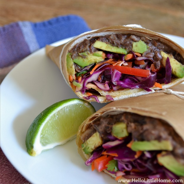Mexican Black Bean Wrap with Avocado and Tri-Color Slaw ... one of 100 Vegetarian Game Day Recipes! Get ready for the big game with over 100 vegetarian and vegan appetizers, soups, chilis, main dishes, sandwiches, breakfast, desserts, and more that will make your next football watching party unforgettable! | Hello Little Home