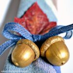 DIY Gilded Acorn Napkin Rings ... this easy fall craft is a fun way to dress up a seasonal or holiday table! | Hello Little Home