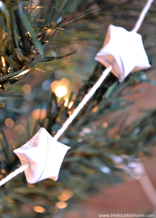 DIY Origami Lucky Star Garland ... an easy origami Christmas garland that's fun to make and the perfect addition to your holiday tree! | Hello Little Home