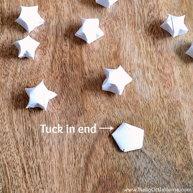 DIY Origami Lucky Star Garland tutorial ... an easy origami Christmas garland that's fun to make and the perfect addition to your holiday tree! | Hello Little Home
