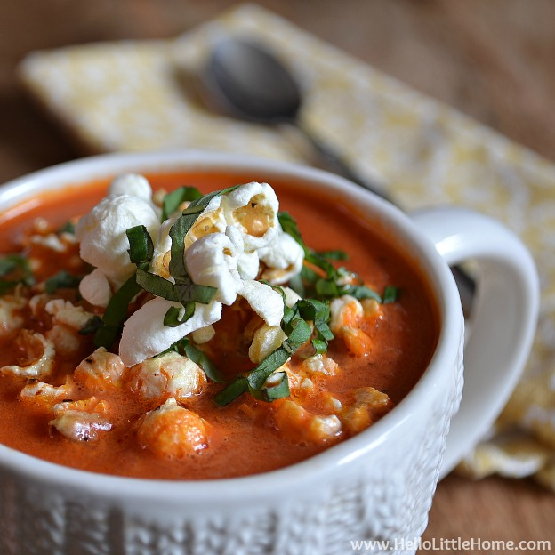 40+ Hearty Vegetarian Soup Recipes, including this Creamy Tomato Soup with Popcorn Croutons, that will warm you up this fall and winter! | Hello Little Home