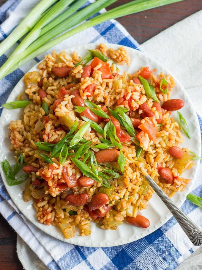 A plate of Vegan Slow Cooker Jambalaya, topped with green onions.
