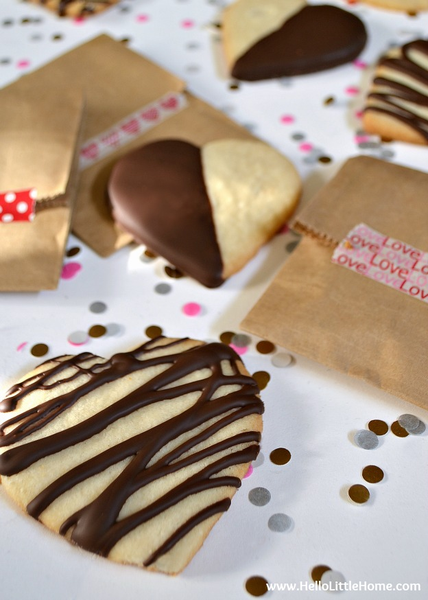 Chocolate-Dipped Shortbread Hearts ... Get this easy recipe + 100 other vegetarian winter recipes that are perfect for any occassion! | Hello Little Home