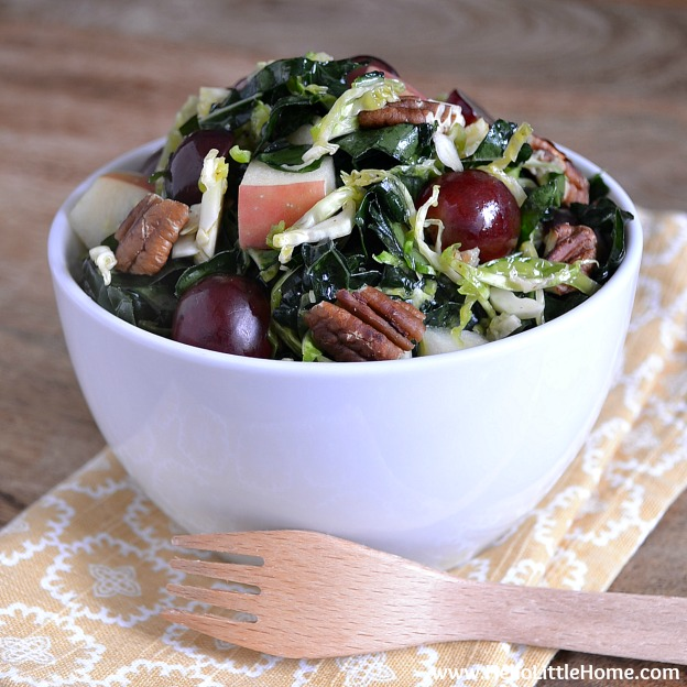 Kale and Brussels Sprouts Salad with Maple Vinaigrette ... yum! Get this easy recipe + 100 other vegetarian fall recipes that are perfect for any occassion! | Hello Little Home