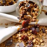 Chocolate-Covered Cherry Granola ... a delicious and easy to make breakfast idea! This healthy granola recipe is packed with tasty, good-for-you ingredients, like quinoa, dark chocolate, oats, and dried cherries. Makes a great snack, too! | Hello Little Home