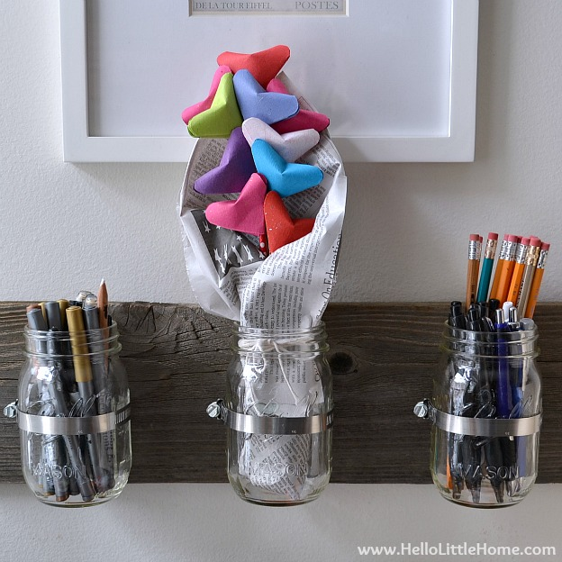 An Origami Bouquet in a wood and mason jar holder.