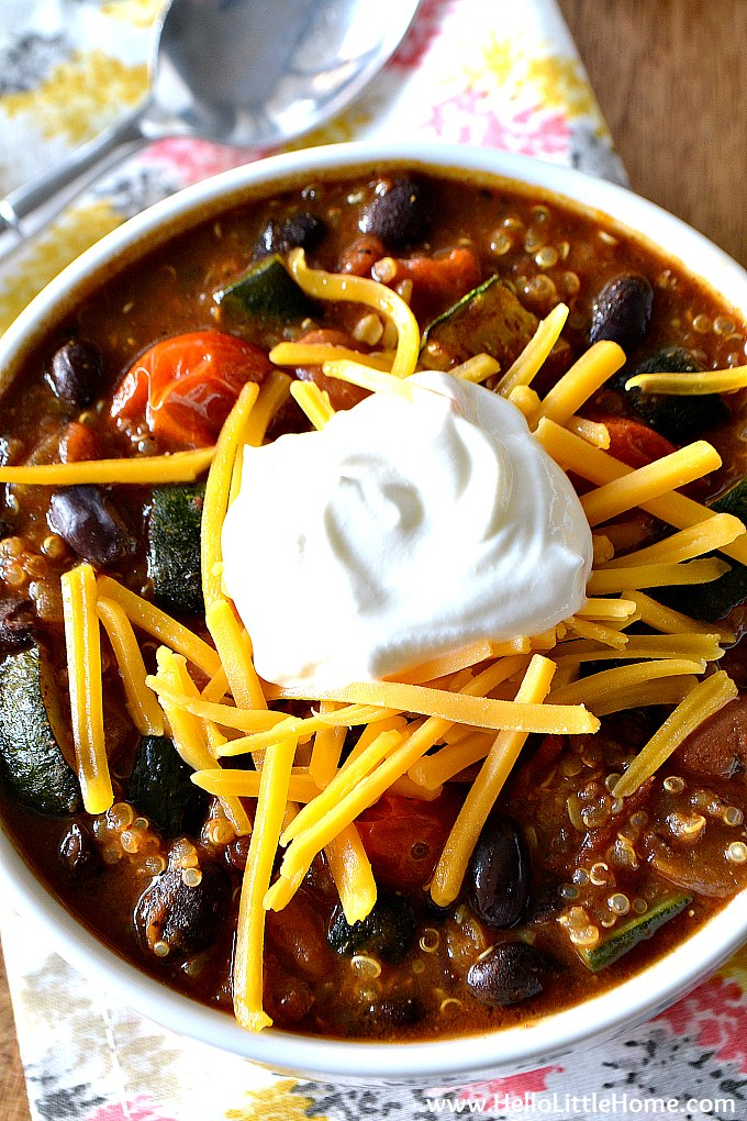 A Bowl of Roasted Vegetable Quinoa Chili on a napkin with a spoon.