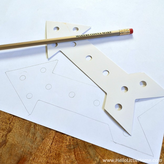 Tracing the pattern for the DIY Arrow Marquee Light. | Hello Little Home