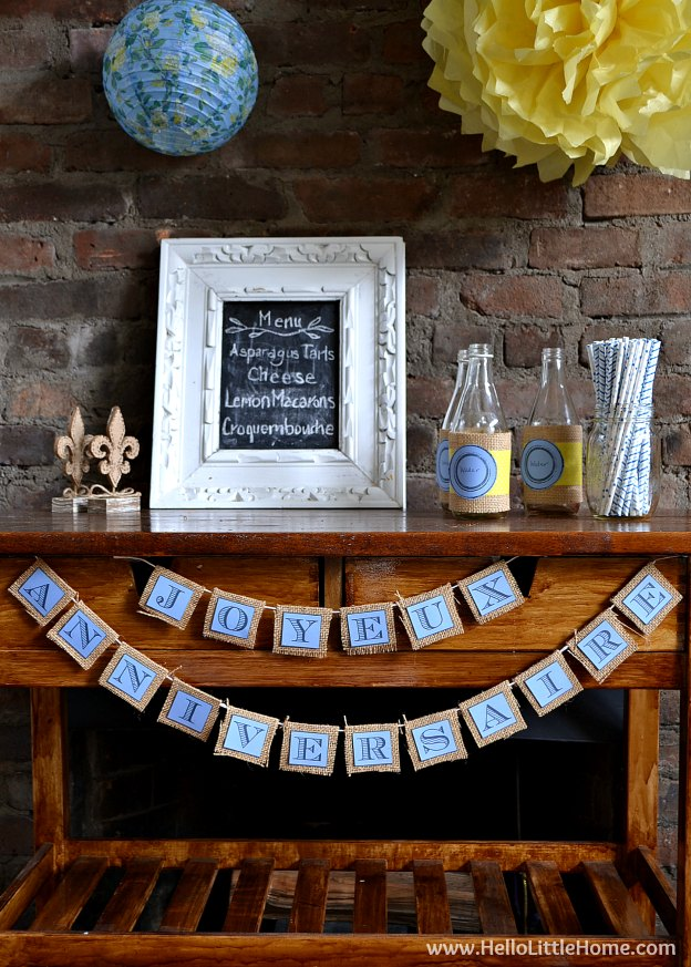 These DIY French Themed Party Decorations with printable Joyeux Anniversaire Banner are perfect for your next party! | Hello Little Home