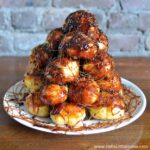 Easy Croquembouche Recipe on a white platter.