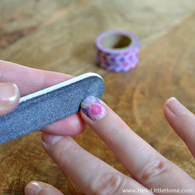 Smoothing edges of Washi Tape Nail Art | Hello Little Home #nails #nailpolish #manicure