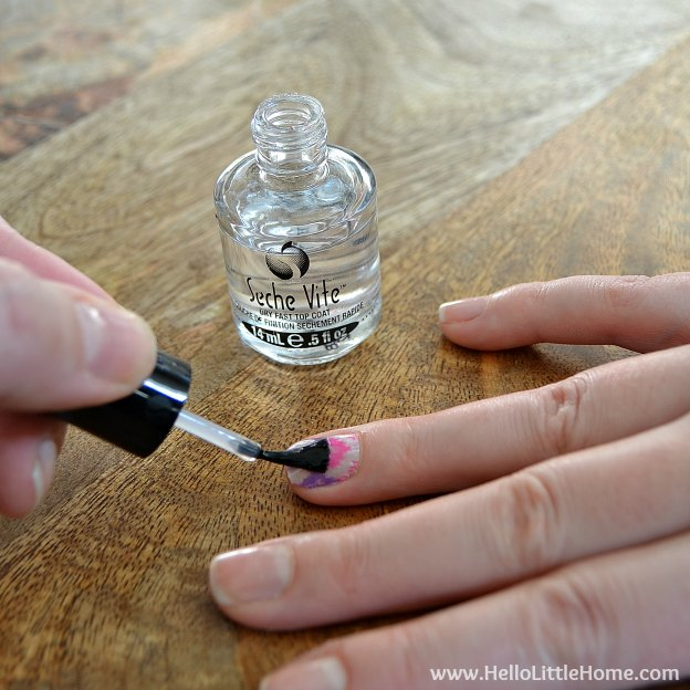Applying top coat over Washi Tape Nail Art | Hello Little Home #nails #nailpolish #manicure