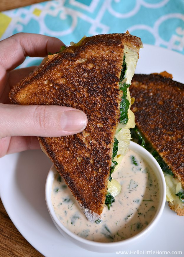 Treat yourself to this Spinach and Artichoke Grilled Cheese with Spicy Ranch Dipping Sauce! | Hello Little Home #sandwich #vegetarian #NationalGrilledCheeseMonth