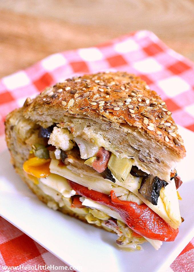 A vegetarian muffaletta sandwich on a plate.