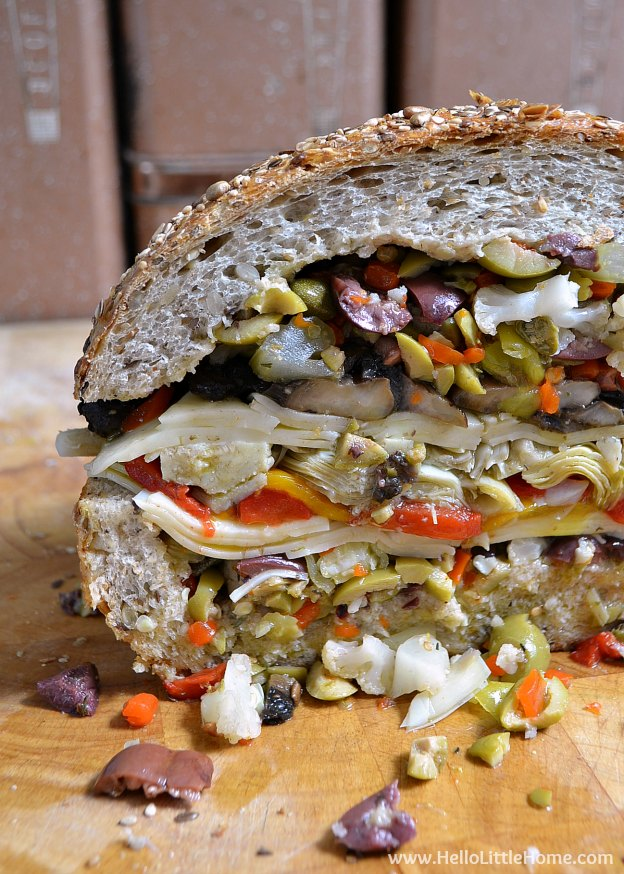 Vegetarian Muffaletta Sandwich ... one of 100 Vegetarian Game Day Recipes! Get ready for the big game with over 100 vegetarian and vegan appetizers, soups, chilis, main dishes, sandwiches, breakfast, desserts, and more that will make your next football watching party unforgettable!   Hello Little Home