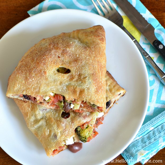 These Broccoli, Feta, and Olive Calzones are quick and easy to make ... the perfect weeknight meal! | Hello Little Home #vegetarian