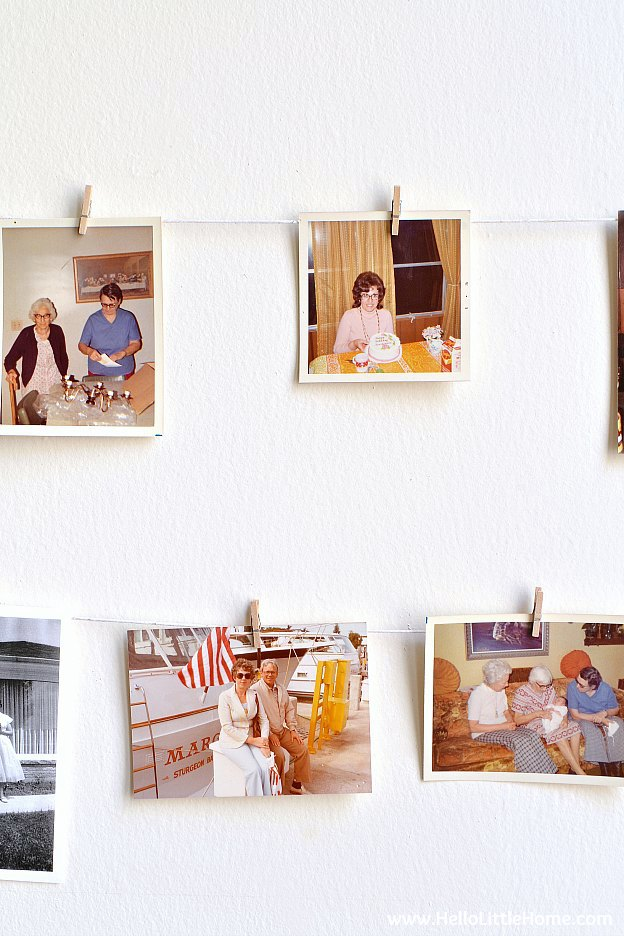 A DIY photo display hung with vintage photos.