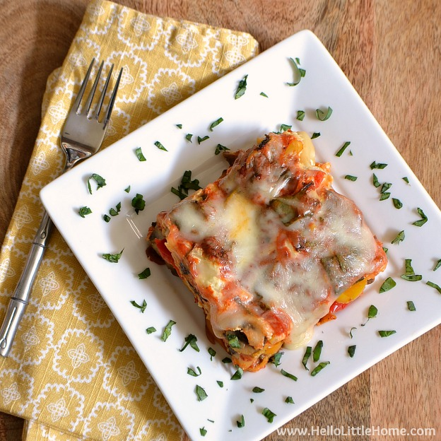 Easy Vegetable Crock Pot Lasagna ... fix it and forget it! This fast vegetarian slow cooker lasagna recipe is easy to make and filled with delicious veggies and lots of cheese ... total comfort food! | Hello Little Home