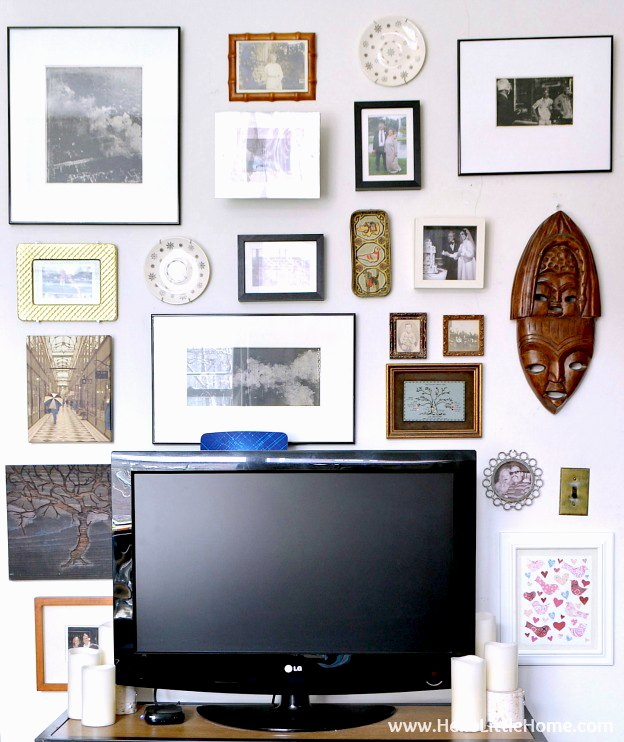A gallery wall surrounding a TV.