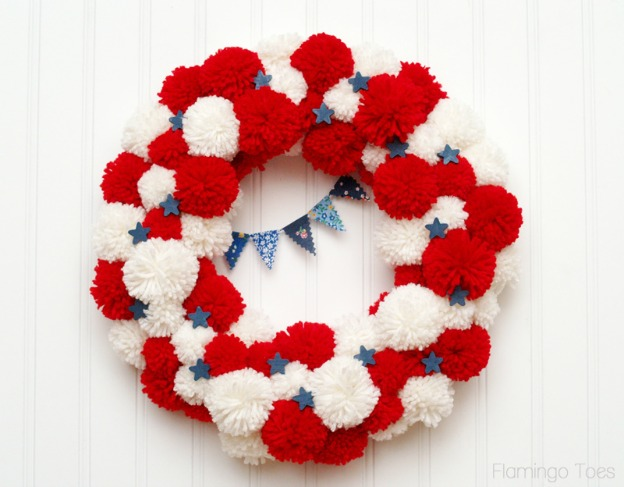 20+ Red, White, and Blue Projects for the 4th of July: Patriotic Pom Pom Wreath from Flamingo Toes | Hello Little Home #FourthOfJuly