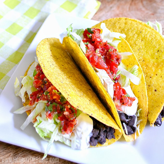 A plate of Crispy Black Bean Tacos with fresh salsa.